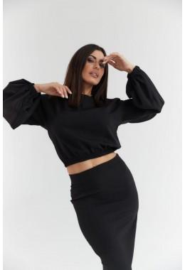 Элегантный черный юбочный костюм