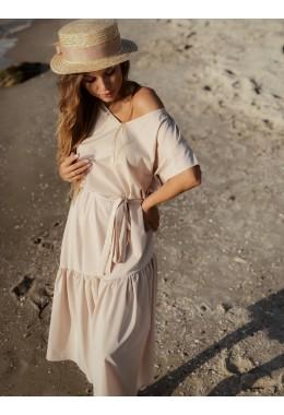 Нежное яркое платье бежевого цвета