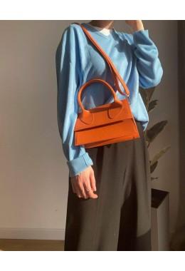 Яркая модная сумка рыжего цвета