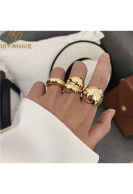 Кольцо массивное золотистое
